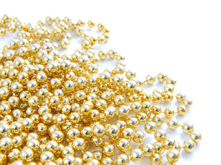 Christmas gold beads are on a white background