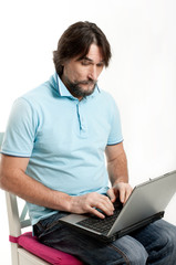 A man with a laptop on a light background