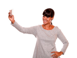 Stylish young female taking a photo with cellphone