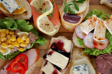 Fresh canapes on a wooden board