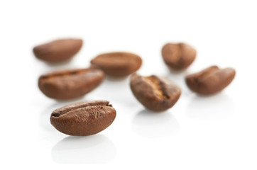 Macro of coffee beans isolated on white background