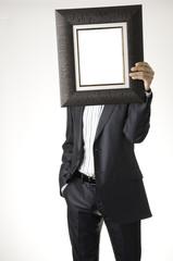 Businessman holding frame