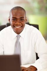 handsome african businessman in office