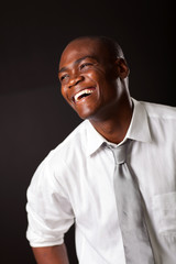 laughing african american man over black background