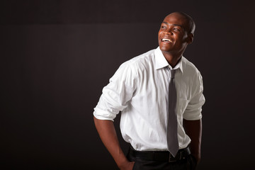 young african american man over black background