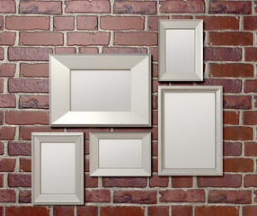 Blank Picture Frames On A Wall Front