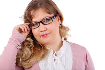 Young beautiful woman in pink blouse and glasses looks at camera