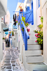 Wall Mural - Beautiful whitewashed street in the old town of Mykonos, Greece