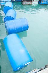 empty plastic barrels