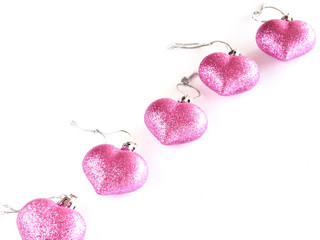 Pink shinny heart ornament isolated on white background