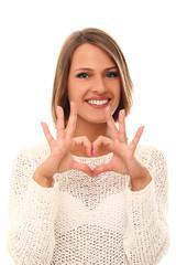 Beautiful woman showing heart gesture
