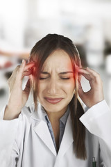 medical woman with headache at hospital