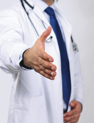 A male doctor giving his hand for a handshake