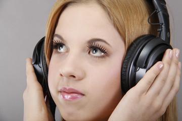 Girl with headphones in the studio