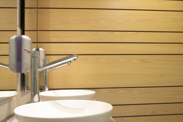 Interior washbasin and wooden wall of a bathroom