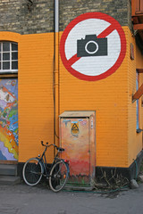 "Wall art ""Do not photograph"" and a bike"