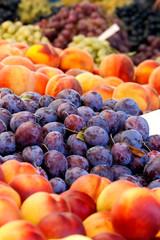 Heap Of Fresh Organic Peaches And Damson Plums