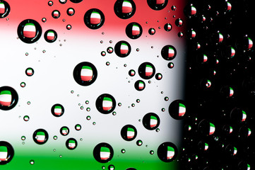 Reflection of Italy flag in water droplets