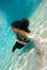 woman undewater in the swimming pool