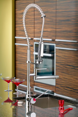 Detail of kitchen with modern single lever faucet