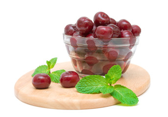 frozen cherries and mint isolated on white background
