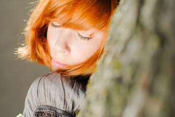 Young happy redhead teenage girl closeup portrait