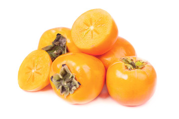 Persimmon fruit whole and sliced on white background