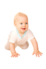 Laughing baby crawling away. Isolated on white