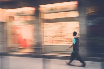 Casual man walking outdoors