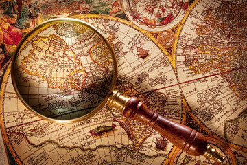 Magnifying glass on old map.