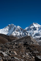 Snowbound mountain peaks and blue sky in Himalayas