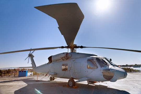 Military helicopter on the carrier deck