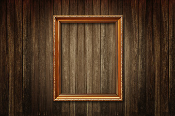 Fototapete - Golden picture frame on old wooden wall