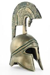 Ancient greek helmet replica on white background