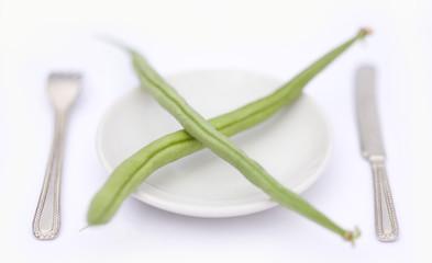 haricots verts sur petite assiette