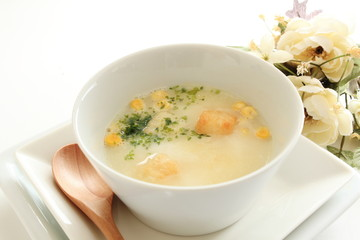 Corn potage with toast and herb on top