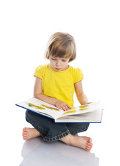 little girl reading a book. isolated over white