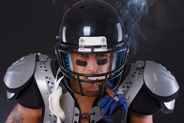 American footbal player smoking cigar portrait