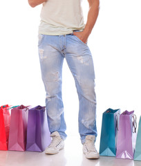 Young fashionable guy with shopping bags