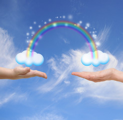 Family concept. Hands of the child and mother touching a cloud w