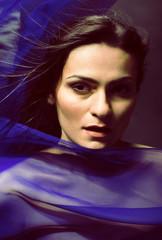 beauty young woman through silk