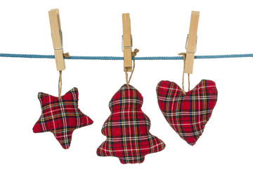 Christmas decorations hang on the clothesline