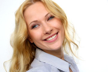 Portrait of charming blond woman on white background