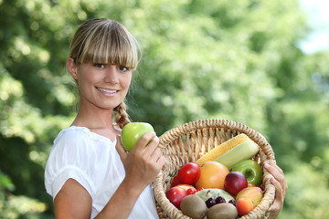 Woman holding a basket of fruit