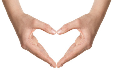 female teen hands show heart shape