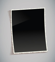 Empty vintage photo frame on table. Black and white