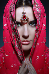Young pretty woman in indian red sari