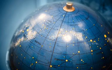 Old star sky globe with Russian text