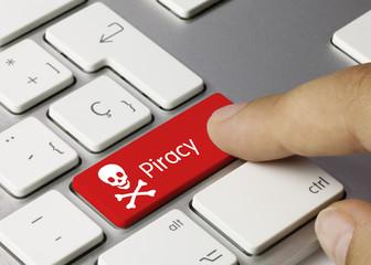 Piracy keyboard key. Finger
