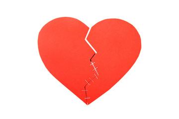 Broken cardboard heart isolated on white background